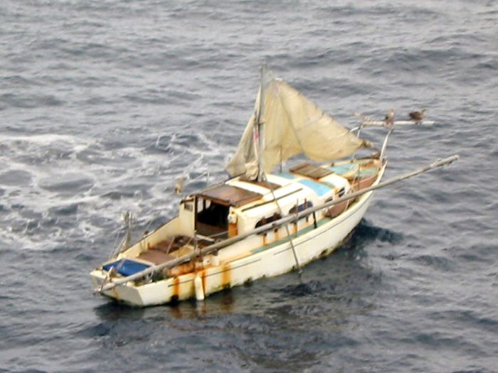 Navy_020917-N-0000X-028_Sailboat_adrift_at_sea_after_U.S._Navy_rescue (1)